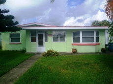 Pet Friendly 2 bedroom 2 bath home with large fenced yard only a short walk to beach.