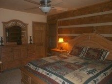 One of two master suites on the main floor has beautiful Broyhill furniture